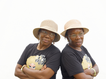 Identical twin sisters in hats and black T-shirts