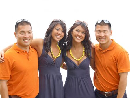Identical twin brothers and sisters arm in arm