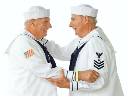 Elderly identical twin brothers dressed as sailors Imagens