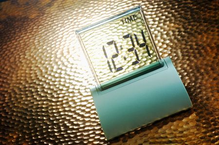 Digital clock showing the time against a spotlighted rippled background Stock Photo - 2060456