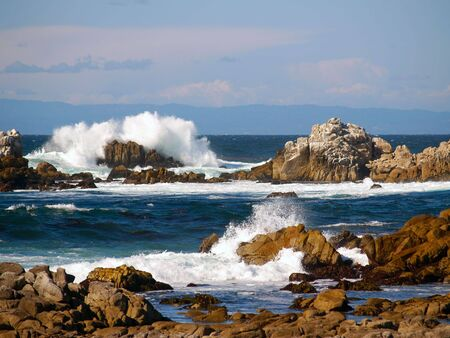 Surf breaking over rocks on the Pacific coast near Monterey