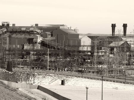Old steel mill in winter, black and white with a vintage look Reklamní fotografie
