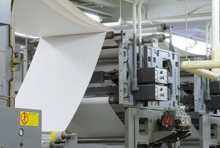 Paper threading its way through a printing press 版權商用圖片