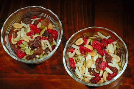A pair of glass dishes filled with cranberry trail mix