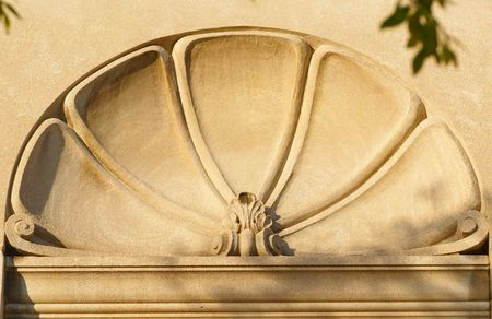 Carved ornamental detail in a stone building, in the shape of a shell