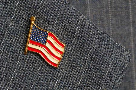 An American flag lapel pin on a pinstripe suit lapel 版權商用圖片