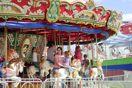 Burton, Ohio - September 5 - Riders on the Merry-go-round at the 188th annual Great Geauga County Fair in Burton, Ohio, on September 5, 2010