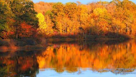 Brilliant autumn colors reflected in a serene lake (Punderson Lake in northeast Ohio)