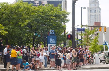 Cleveland - August 17, 2011: Crowds of spectators gather to watch production of the blockbuster movie The Avengers being shot on a downtown Cleveland street.