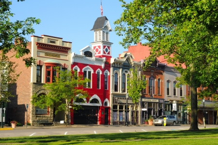 Medina, Ohio - May 19, 2012: East Washington Street in Medina, Ohio, features a historic town hall and firehouse (bright red building) more than 130 years old.