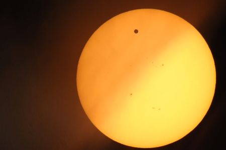 Transit of Venus across the sun, with partial obscuration by clouds