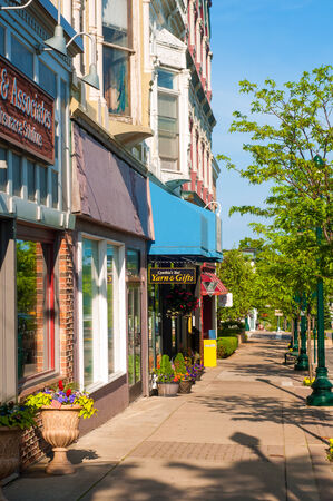 PETOSKEY, MI - JUNE 27: Shops and businesses along Mitchell Street (observer facing west) in Petoskey