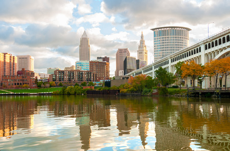 Downtown Cleveland Ohio rises above the Cuyahoga River at Heritage Park in morning light Imagens