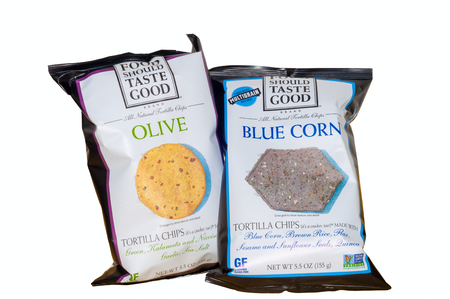 TWINSBURG, OH, USA - JANUARY 22, 2015: Two 5.5 oz. bags of Food Should Taste Good tortilla chips in olive and blue corn. Food Should Taste good is a recent entry into the organic and healthy snacks market.