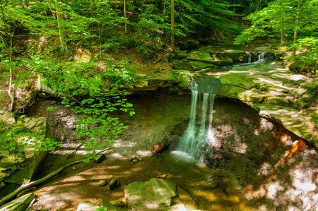 Blue Hen Falls in Cuyahoga Valley National Park on a summer morning with light and shadow