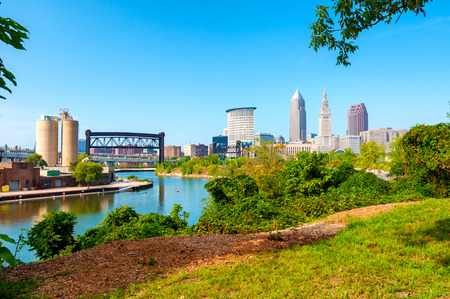View of downtown Cleveland, Ohio, and the Cuyahoga River from a park on the west bank of the river