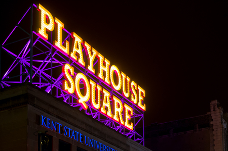 CLEVELAND, OH - JANUARY 1, 2016: Cleveland's theater district, Playhouse Square, is announced by a massive rooftop lighted sign on Euclid Avenue, above a Kent State University branch campus. Sajtókép