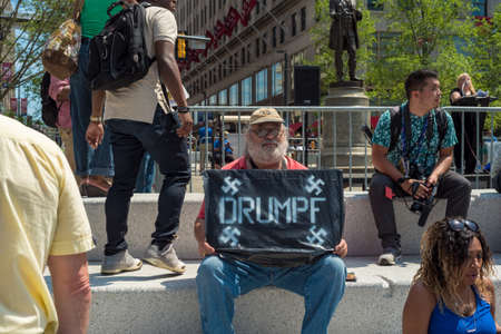 CLEVELAND, OH - JULY 20, 2016: A anti-Trump protester holds a sign with Nazi connotations on Public Square during the Republican National Convention. Editöryel