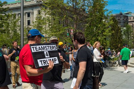 CLEVELAND, OH - JULY 20, 2016: A Trump supporter holds a sign among the crowds of people on Public Square during the Republican National Convention Editöryel