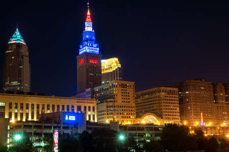 CLEVELAND, OH - MAY 28, 2016: View of Clevelands three tallest buildings�the Key Tower, the Terminal Tower, and the BP building�lit up at night above the riverfront district.