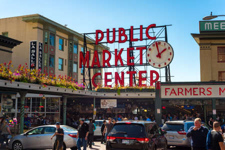 SEATTLE, WA - SEPTEMBER 11, 2016: The Pike Place Market, with its famous sign and clock, attracts large crowds of visitors every day.