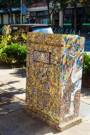 SEATTLE, WA - SEPTEMBER 11, 2016: A graffiti-covered traffic signal control box in the Belltown neighborhood displays a unique example of this citys hip urban art. Editorial