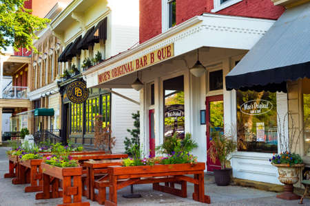 GRANVILLE, OH - MAY 15, 2017: Sidewalk seating is a feature at Moe's Bar B Que and other establishments on the main street of this charming east-central Ohio village.