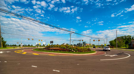 TWINSBURG, OH = JUNE 24, 2017: A newly installed roundabout in Twinsburg, Ohio, replaces a conventional intersection, providing a challenge for some drivers to navigate.