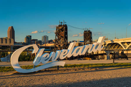 A Cleveland sign, one of three in the city, overlooking downtown from the near west side Фото со стока - 88498442