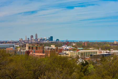 The downtown Cleveland skyline, Lake Erie, and the cultural and medical institutions seen from a high vantage on the city's east side 写真素材