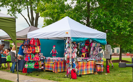 TWINSBURG, OH - JUNE 9, 2018: A home goods and fabrics craft booth sports a colorful display at A Taste of Twinsburg, an outdoor culinary and arts festival held one Saturday in summer on the town square. Editorial