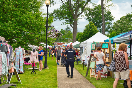 TWINSBURG, OH - JUNE 9, 2018: Visitors stroll between vendor booths for A Taste of Twinsburg, an outdoor culinary and arts festival held one Saturday in summer on the town square. Editorial