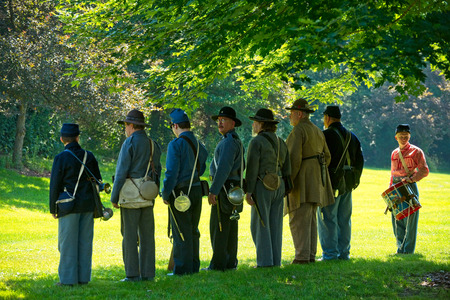 TWINSBURG, OH - JUNE 30, 2018: A mix of Union and Confederate reenactors line up in the shade during an all-day history event at the Twinsburg Public Library.