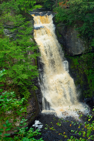 Bushkill Falls in northeast Pennsylvania drops over 100 feet on the way to the Delaware River. Stok Fotoğraf
