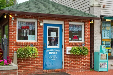 COOPERSTOWN, NY - SEPTEMBER 8, 2018: The famous Cooperstown Diner occupies a tiny space on Main Street, but it is popular with visitors and locals alike in this upstate NY town.