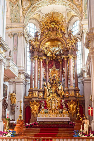 MUNICH, GERMANY - MAY 24, 2019: The high altar inside the Peterskirche (Peter's Church) is a masterpiece of baroque art. The church, populary called Alter Peter (Old Pete) is the city's oldest.