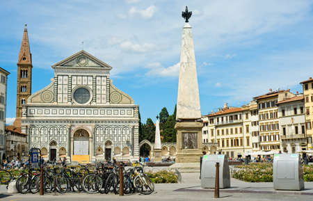 FLORENCE, ITALY - JUNE 1, 2019: The Piazza di Santa Maria Novella is a popular gathering spot in the city and is fronted on the north side by the picturesque basilica of the same name. Editoriali