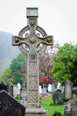 Celtic cross in a cementery at Glendalough (Ireland)