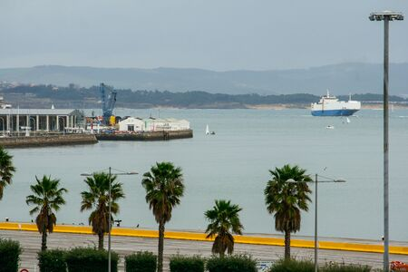 Seafront of the city of Santander, palace of festivals of Cantabria. Ferry and sailboats