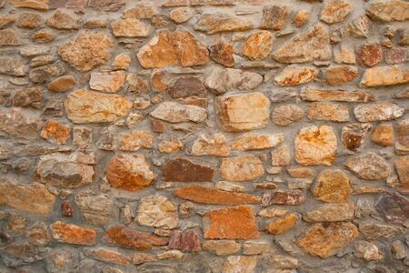 Background, material, texture of a natural stone facade Stock fotó