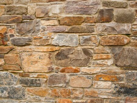 Background, material, texture of a natural stone facade Imagens