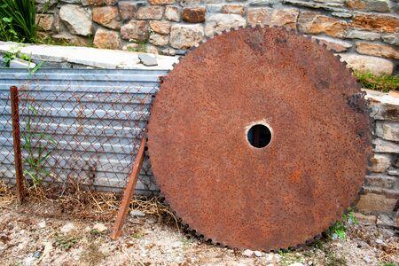 Rusty old circular serrated saw