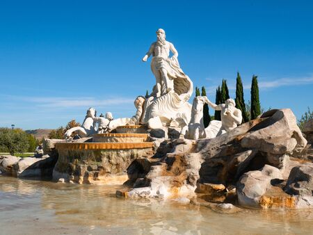 Torrejon de Ardoz, Madrid, Spain; 10/26/2019; Replica of the Trevi Fountain in the Europa Park of Torrejon de Ardoz with a beautiful blue sky with clouds in the background Stock Photo