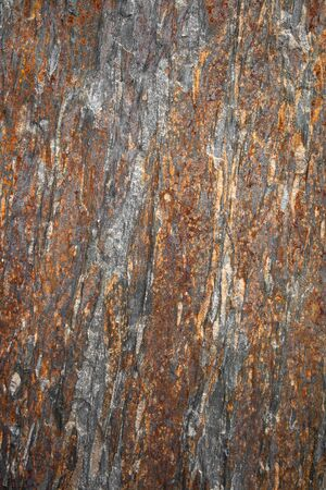 Abstract background of surface of a quarry stone with iron streaks