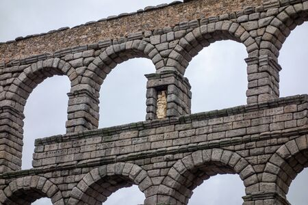 Segovia, Spain; 01112019: Segovia aqueduct on a cloudy, detail of the sculpture of the Virgin of Fuencisla