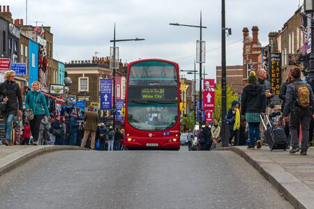London, England; 04/22/2016: English double decker bus crossing the streets of Camden Town