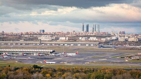 Madrid, Spain; 11/23/2019: Sunrise at the airport Adolfo Suarez Madrid Barajas overlooking the city skyline and the