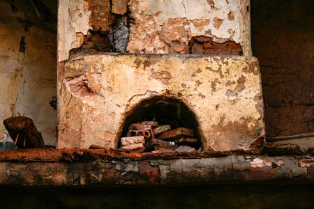 Cracked and broken chimney inside a collapsed house