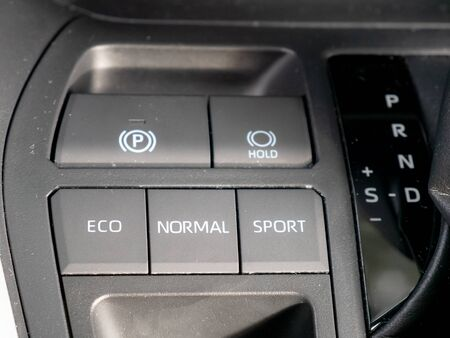 Buttons on the dashboard of a hybrid vehicle indicating the driving modes and the letters of the hybrid transmission of the gear lever