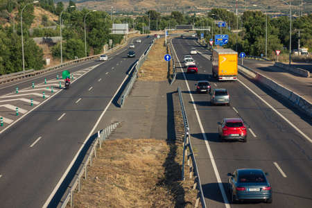 Madrid, Spain; 06/21/2020: Exit road from Madrid to Valencia during a summer departure operation with a multitude of vehicles Editoriali